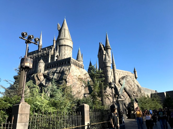 The towers of Hogwarts against a bright blue sky