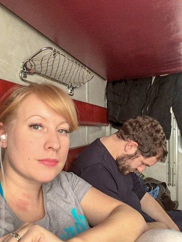 Rosie and Karl in a second class coupe on the Trans-Siberian Train Russia