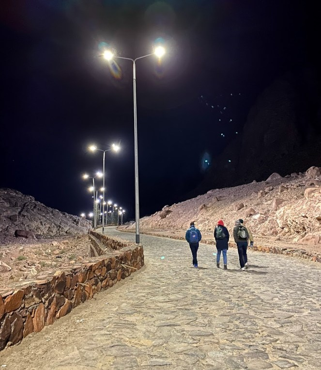 A wide paved path with streetlights up to Mount Sina, Egypt