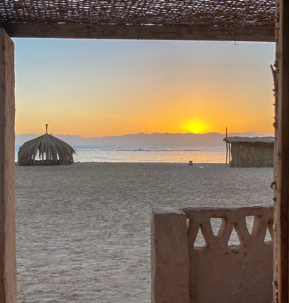 Sunrise view from a Husha hut on the beach at Aqua Sun, Gulf of Aqaba, Egypt