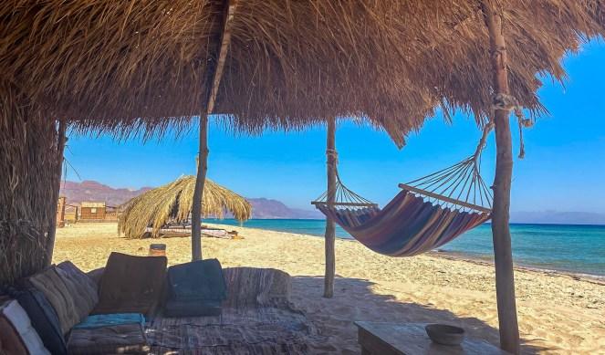a hammock in a palm hut on the beach at Aqua Sun Beach Camp, Sinai, Egpyt