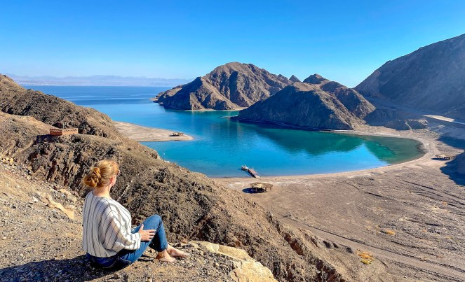 Rosie sits looking over Fjord Bay in the Gulf of Aqaba, Egypt