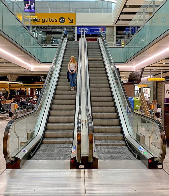 Rosie coming down an escalator at London Heathrow Terminal 5
