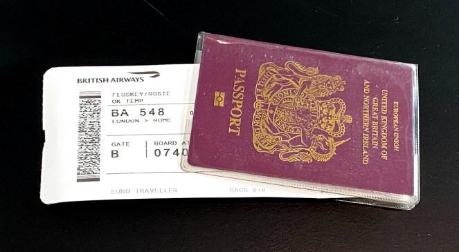 British Airways boarding card inside a red UK passport