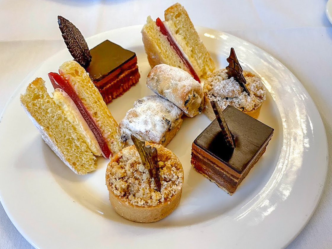 a selection of cakes, tarts and stollen on the sweet afternoon tea plate