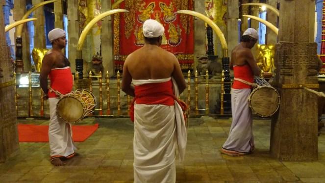 3 male drummers inside Sri Dalada Maligawa Buddhist Temple of the Tooth, Kandy, Sri Lanka