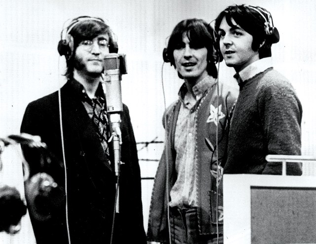 The Beatles singing intoa U47