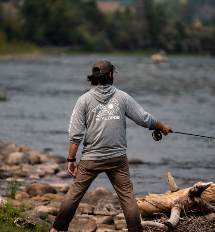 standing with fly rod in hand