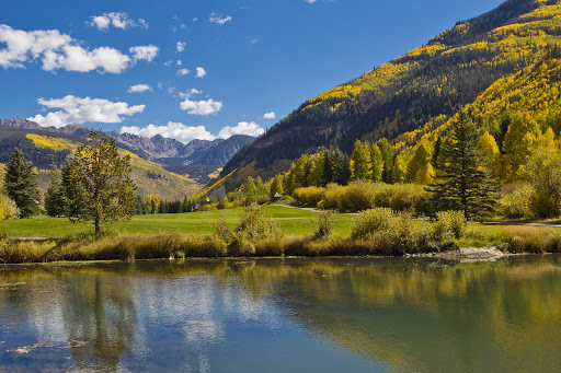 Landscape view of the Vail Valley including a pond and the Gore Mountain Range