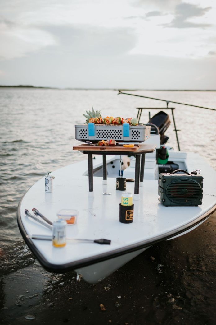 boat with speaker and grill on it