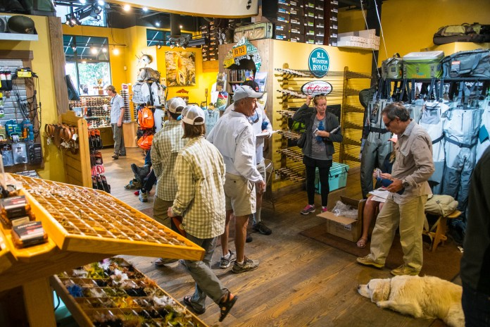 Guides and anglers interacting in a fly shop