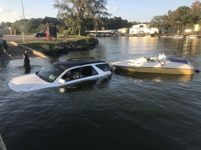 car backing into water