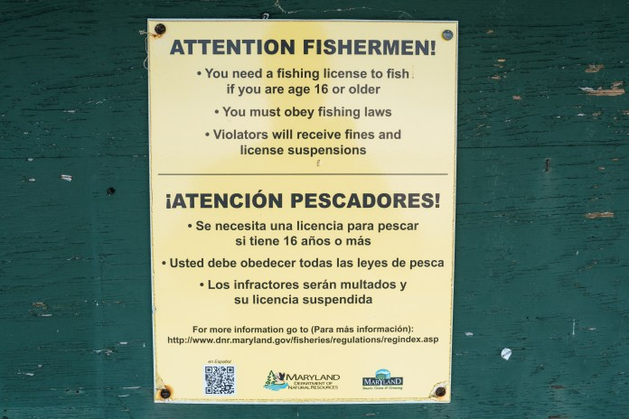 A sign with fishing regulations