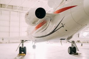 jet plane rear quarter in hanger bright light