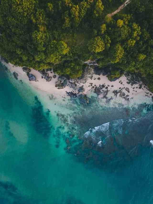 Aerial view of Uluwatu cliffs and beach in Bali