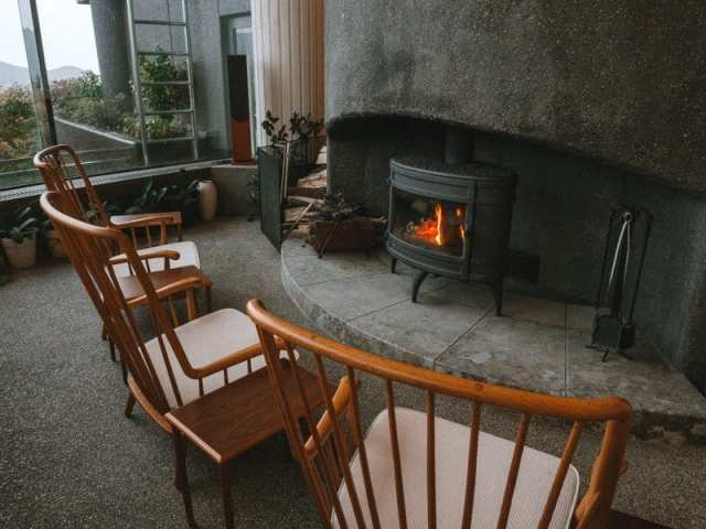 Chairs by the fireplace at Hotel Hakone Gora Byakudan