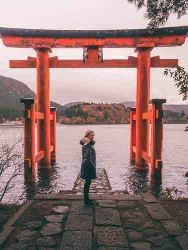 Orange torii gate overlooking lake Ashinoko in Hakone