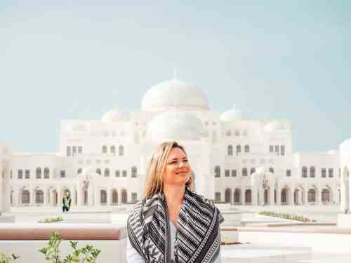 Girl wearing aztec scarf with the Abu Dhabi Presidential Palace in the background