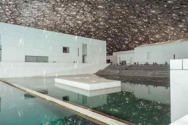 Central pool at the Louvre Abu Dhabi under the helix dome roof