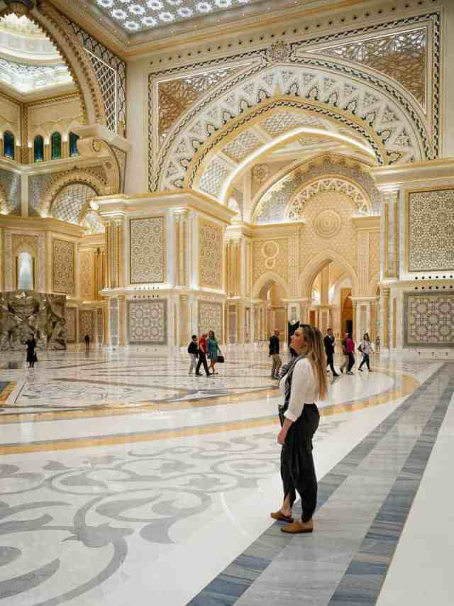 Girl standing in the lobby of the Abu Dhabi Presidential Palace, United Arab Emirates