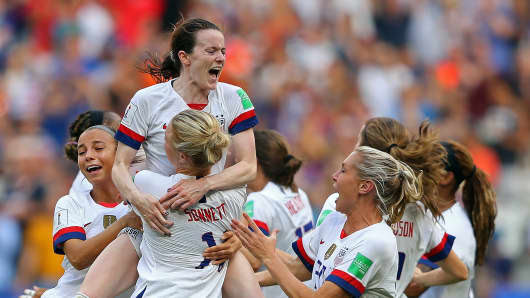 Rose Lavelle of the USA celebrates with teammates following the 2019 FIFA Women's World Cup France Final match between The United States of America and The Netherlands at Stade de Lyon on July 07, 2019 in Lyon, France.