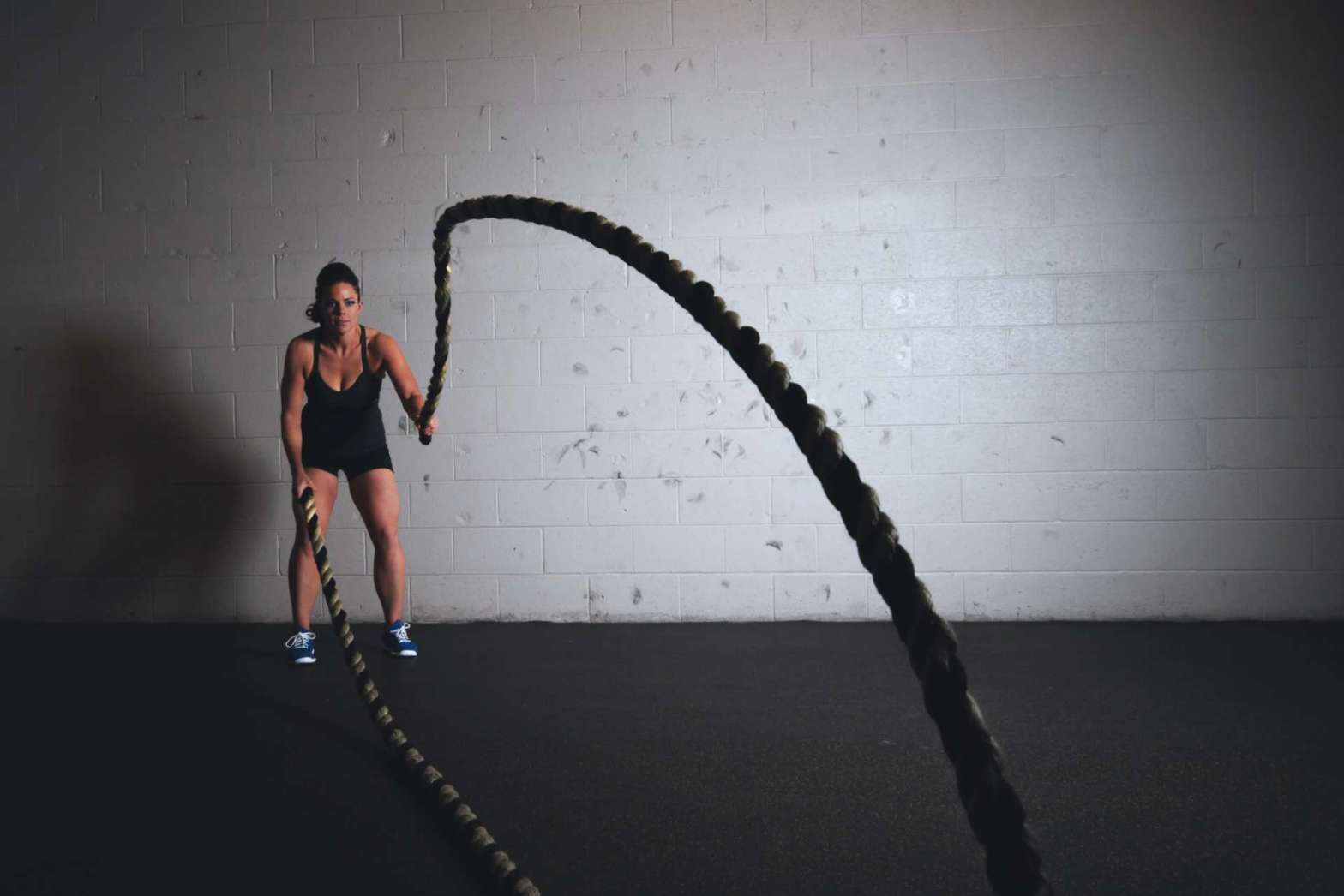 Woman working out with ropes