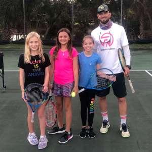 Brandon Flanagan with junior tennis players