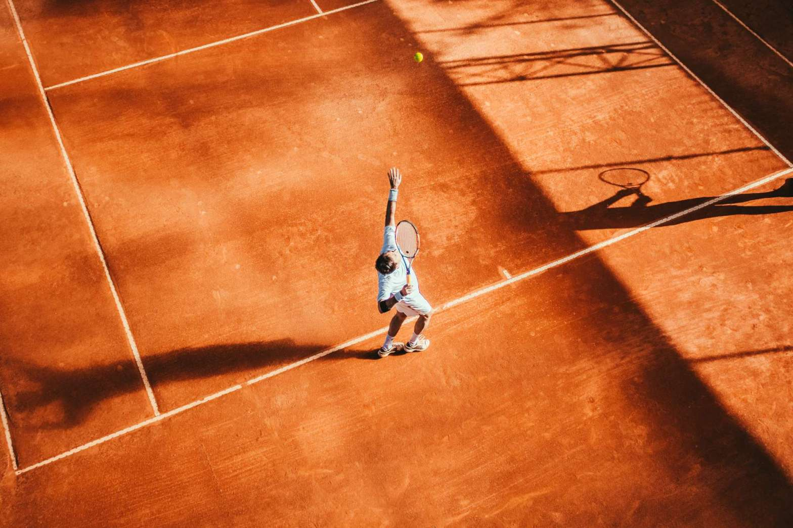 Tennis player on red clay court