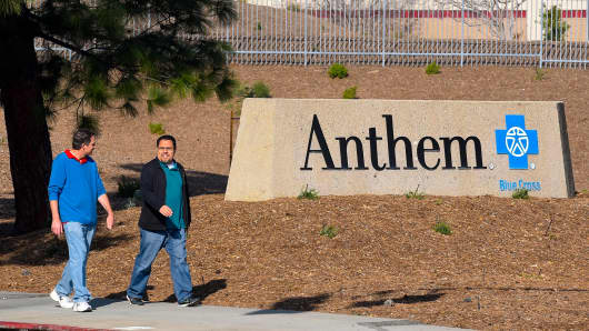 People walk past an office building of health insurer Anthem in Los Angeles, California.