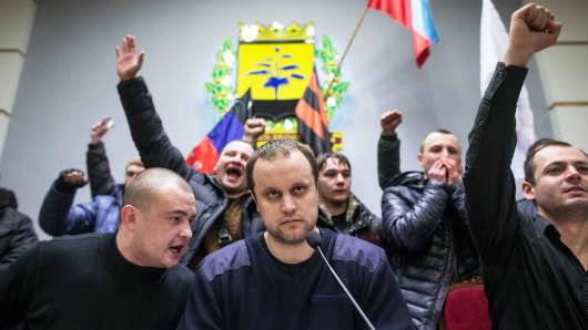 Pavel Gubarev, center, a separatist leader, in the parliament chamber in Donetsk, Ukraine.