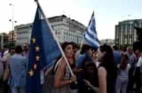 A protester holds an EU flag during a pro-European demonstration in front of the Greek parliament in Athens on June 18, 2015.
