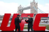 Michael Bisping (R) and Anderson Silva face off at Tower Bridge on February 25, 2016 in London, England.