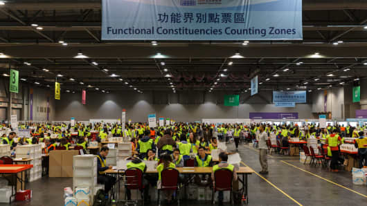 Electoral officials count votes cast in the Legislative Council election at the central counting station in Hong Kong on September 5, 2016.