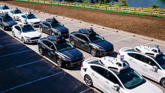 Pilot models of the Uber self-driving car are displayed at the Uber Advanced Technologies Center on September 13, 2016, in Pittsburgh.