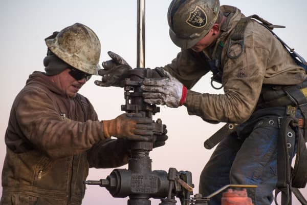 Oil field workers on a rig in Tioga, North Dakota.