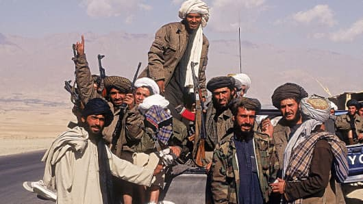 Taliban fighters with a vehicle on highways in Afghanistan.