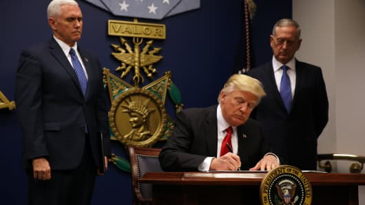 U.S. President Donald Trump signs an executive order he said would impose tighter vetting to prevent foreign terrorists from entering the United States at the Pentagon in Washington, U.S