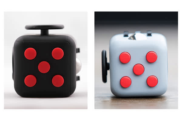 A Stress Cube (left) compared with a Fidget Cube (right).