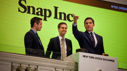 Bobby Murphy, co-founder and chief technology officer at Snap Inc., from left, Evan Spiegel, co-founder and chief executive officer of Snap Inc., ring the opening bell at the New York Stock Exchange (NYSE) with Tom Farley, president of the NYSE Group, during the company's initial public offering (IPO) in New York, U.S., on Thursday, March 2, 2017.