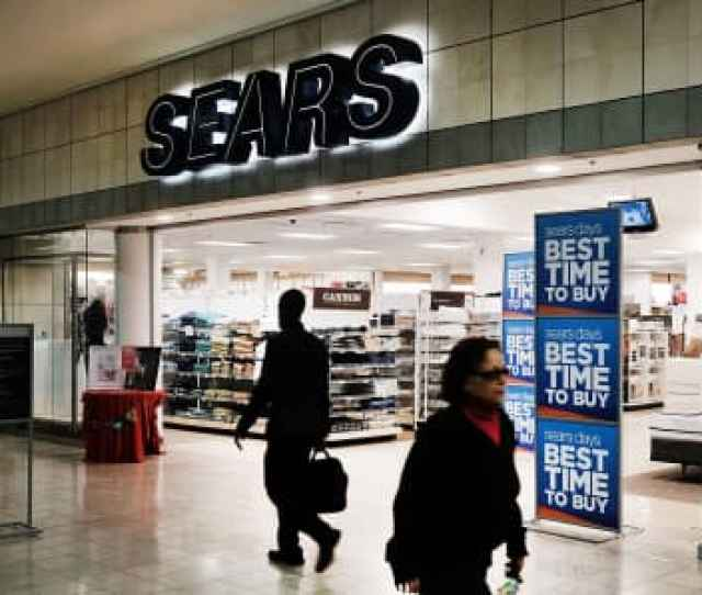 People Walk By A Sears Store In A Nearly Empty Westfield Meriden Shopping Mall In