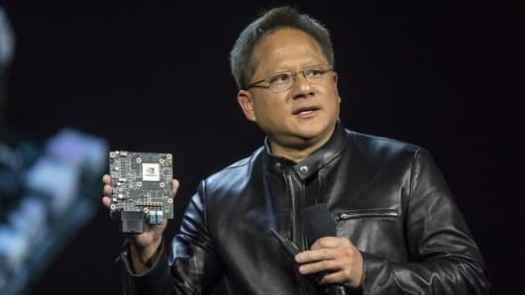 Jen-Hsun Huang, president and chief executive officer of Nvidia Corp., holds the Nvidia Xavier high-end computing module as he speaks during a keynote presentation at the 2017 Consumer Electronics Show in Las Vegas, Jan. 4, 2017.