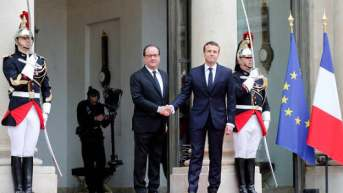 Image result for France's Macron pledges to overcome division in society