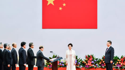 Carrie Lam Cheng Yuet-Ngor,(Right) Hong Kong's new Chief Executive and her new cabinet are sworn in by Chinese President Xi Jinping during an inauguration ceremony in Hong Kong
