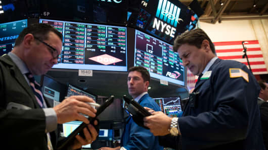 Traders and financial professionals work on the floor of the New York Stock Exchange (NYSE).