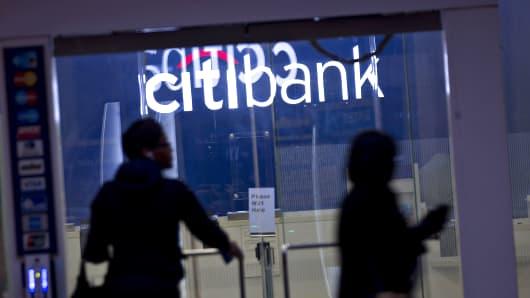 Pedestrians walk past a Citibank branch in Washington, D.C.