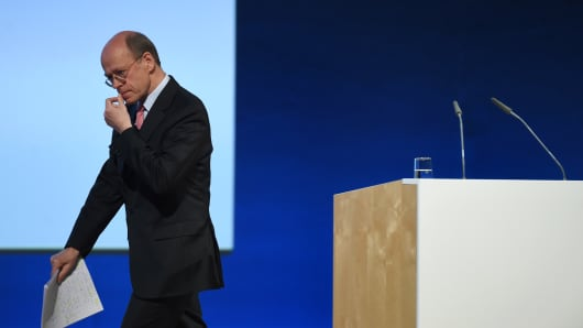 Nikolaus von Bomhard, CEO of German reinsurance giant Munich Re, leaves the speaker point after his speech during the company's annual general meeting in Munich, southern Germany, on April 26, 2017.