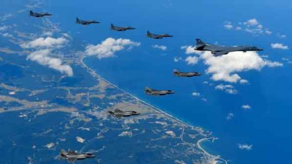 In this handout image provided by South Korean Defense Ministry, U.S. Air Force B-1B Lancer bombers flying with F-35B fighter jets and South Korean Air Force F-15K fighter jets during a training at the Pilsung Firing Range on September 18, 2017 in Gangwon-do, South Korea. U.S. F-35B stealth jets and B-1B bombers flew near the Military Demarcation Line (MDL) for the first time since recent tension between U.S. and North Korea started raising.