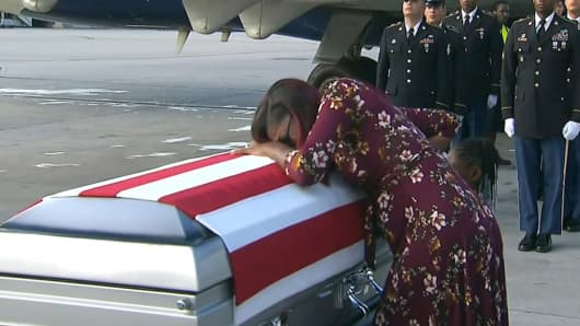 In this Tuesday, Oct. 17, 2017, frame from video, Myeshia Johnson cries over the casket of her husband, Sgt. La David Johnson, who was killed in an ambush in Niger, upon his body's arrival in Miami.