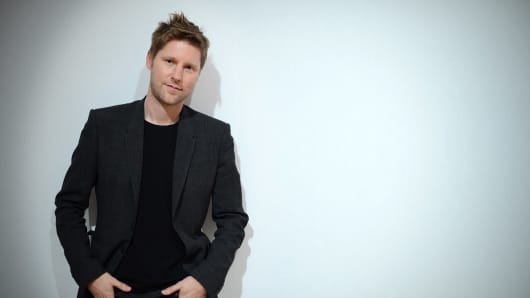 British designer Christopher Bailey poses backstage ahead of his Burberry Prorsum 2013 spring/summer collection catwalk show at London Fashion Week in London on September 17, 2012.