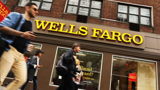 People walk by a Wells Fargo bank branch on October 13, 2017 in New York City.